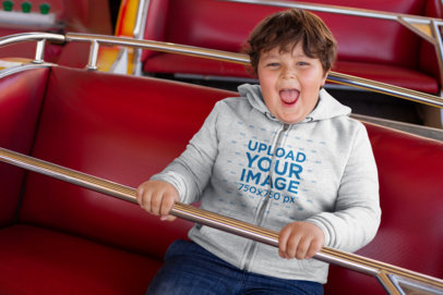 Plus Size Hoodie Mockup of Kid Having Fun In a Fair Ride 25551
