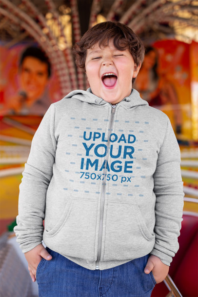 Mockup of a Laughing Kid Wearing a Plus Size Full-Zip Hoodie in a Carousel 25552