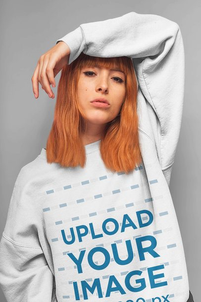 Sweatshirt Mockup of a Red-Haired Girl with an Arm over Her Head 20874