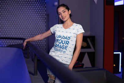 T-Shirt Mockup of a Girl Posing in an Arcade Place 24920