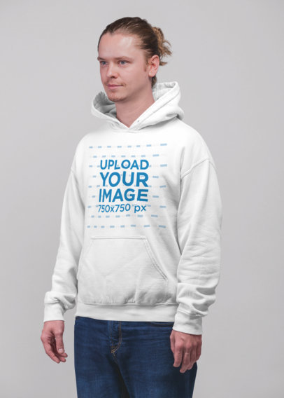 Hoodie Mockup of a Young Blonde Man Standing in a Studio 23080