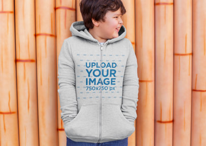 Mockup of a Happy Boy Wearing a Plus Size Zip-Up Hoodie 25554