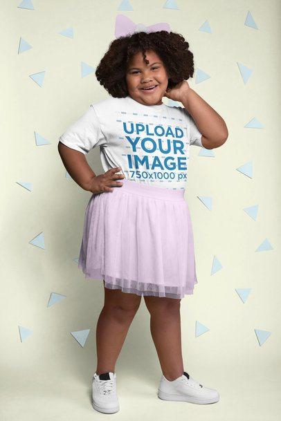 Plus Size Tee Mockup of a Joyful Girl with Curly Hair Surrounded by Cut out Paper Shapes 25569