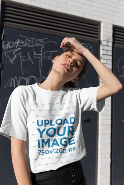 T-Shirt Mockup of a Girl Posing in Front of a Graffiti 25784