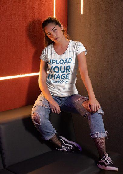 V-Neck Tee Mockup of a Girl Sitting Against Cool Led Lights 24912