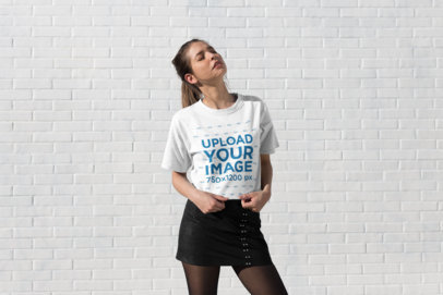 Tee Mockup of a Stylish Girl Standing in the Sun with Her Eyes Closed 25786