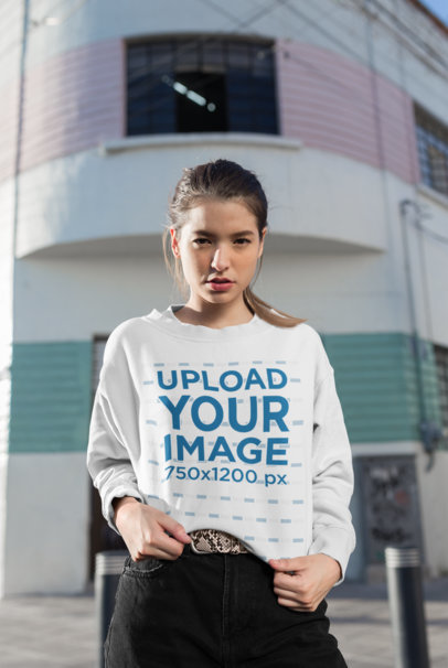 Mockup of a Girl Wearing a Baggy Sweatshirt on the Street 25792