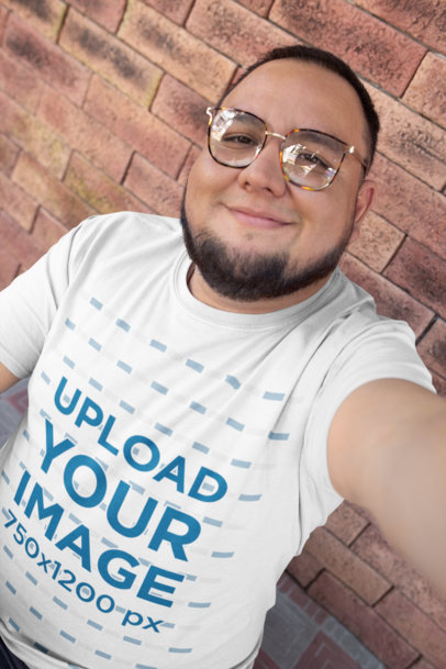 T-Shirt Mockup of a Happy Customer with Retro Glasses Taking a Selfie 26193