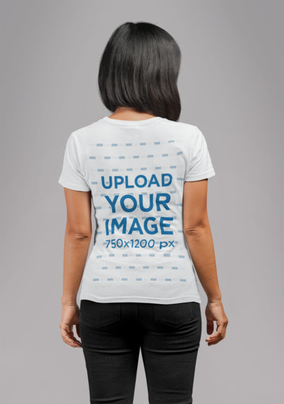 Back View T-Shirt Mockup Featuring a Woman in a Studio 21726