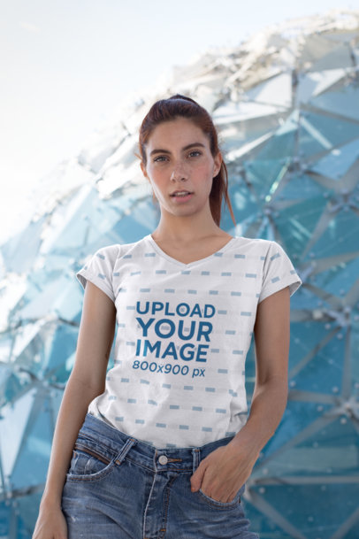 V-Neck Tee Mockup of a Thin Girl with Freckles in Front of a Geodesic Dome 24984