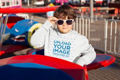 Plus Size Pullover Hoodie Mockup of a Kid with Sunglasses in a Theme Park Ride 25566
