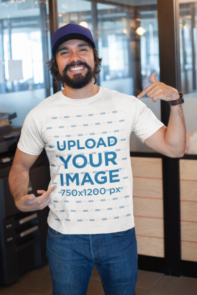 Mockup of a Happy Customer Showing off His T-Shirt Inside a Modern Office 26189