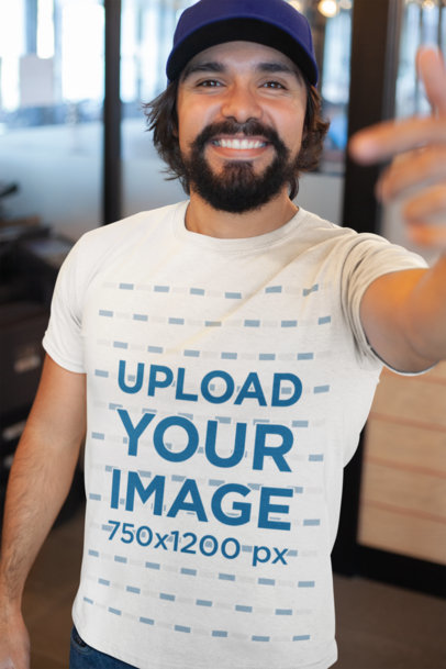 T-Shirt Mockup Featuring a Happy Customer Smiling at the Camera 26190
