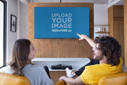 Mockup of Two Friends Having Fun While Watching TV 25827