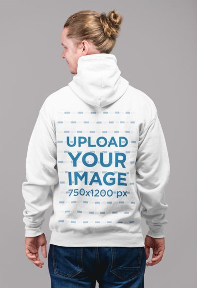 Back Full-Zip Hoodie Mockup of a Blonde Man with a Hair Bun Standing Inside a Studio 23098