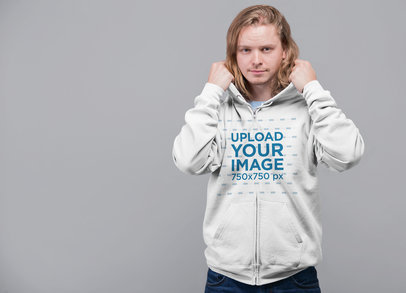 Mockup Featuring a Long-Haired Man Putting on His Full-Zip Hoodie 23101
