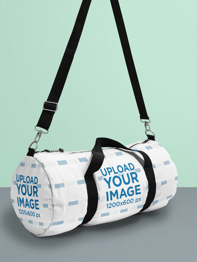 Duffle Bag Mockup Hanging Inside a Bright-Colored Setting 25169
