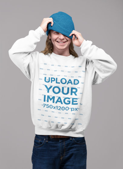 Sweatshirt Mockup of a Playful Man Having Fun with His Beanie 23094