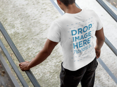 T-Shirt Mockup of a Young Man Walking Down a Ramp 6096a