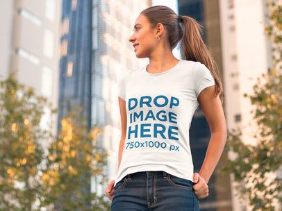 Clothing Mockup of a Woman in a T-Shirt Walking Around Town 6562a