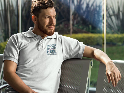 Collar Shirt Mockup Featuring a Man Sitting on a Bench 7220a