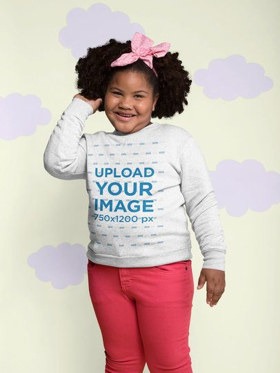 Plus Size Sweatshirt Mockup of a Smiling Little Girl with a Bow Surrounded by Paper Clouds 25573