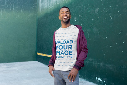T-Shirt Mockup of a Smiling Man with a Casual Look 25929