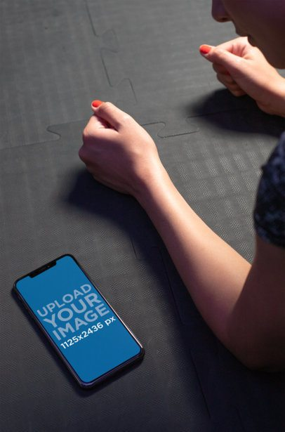 iPhone XS Mockup Featuring a Girl Doing a Plank 25980