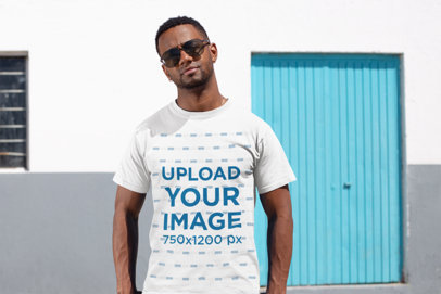 T-Shirt Mockup of a Man Wearing Sunglasses in an Urban Neighborhood 25932