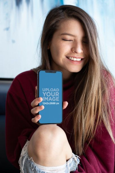Mockup of a Smiling Girl Resting Her iPhone XS Max on Her Knee 25829