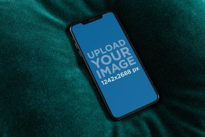 iPhone XS Max Mockup Lying over a Dark Blanket 25886