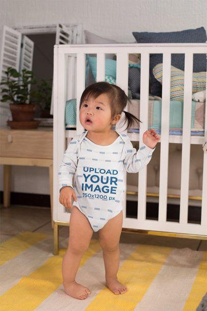 Onesie Mockup of a Sweet Baby Girl in Her Bedroom 25137