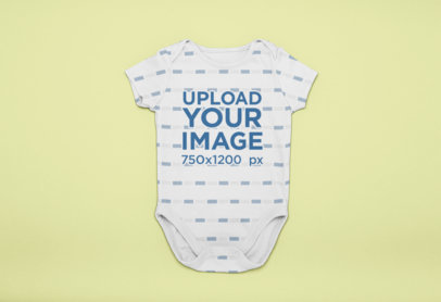 Onesie Mockup over a Solid Surface 25127