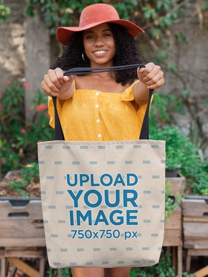 Mockup of a Good-Looking Girl in a Summer Look Holding a Tote Bag 26688