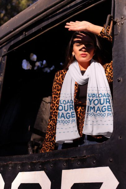 Scarf Mockup of a Woman Inside an Old Railroad Car Covering Her Face from the Sun 25664