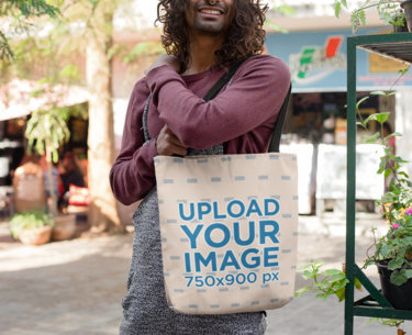 Tote Bag Mockup of a Trendy Man with Long Hair in the Street 26702