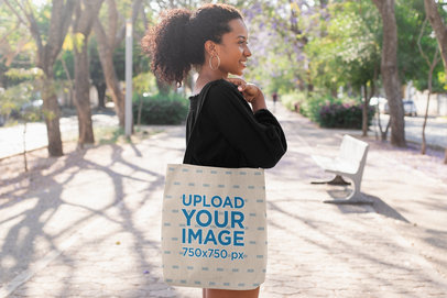Tote Bag Mockup of a Girl with a Kinky Hair Ponytail at a Park 26696