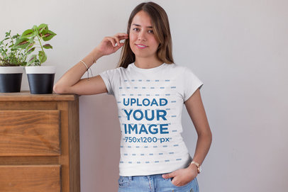 Tee Mockup of a Blonde Woman Leaning over a Wooden Chest of Drawers 26347