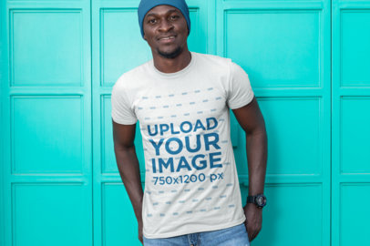 T-Shirt Mockup of a Man with a Beanie Standing by a Gate 26439