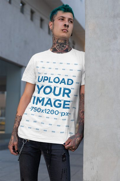 T-Shirt Mockup Featuring a Tattooed Man Leaning over a Concrete Wall 26473