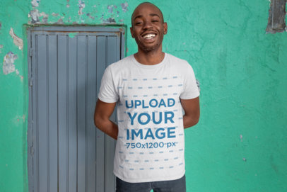 T-Shirt Mockup of a Friendly-Looking Man in an Urban Area 26317