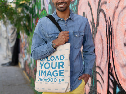 Tote Bag Mockup of a Smiling Man Wearing a Denim Shirt 26707