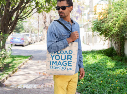 Mockup of a Man with Sunglasses Carrying a Tote Bag on His Shoulder 26709