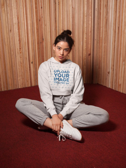 Crop Top Hoodie Mockup of a Cute Girl Sitting on the Floor of a Vintage-Looking Room 26100