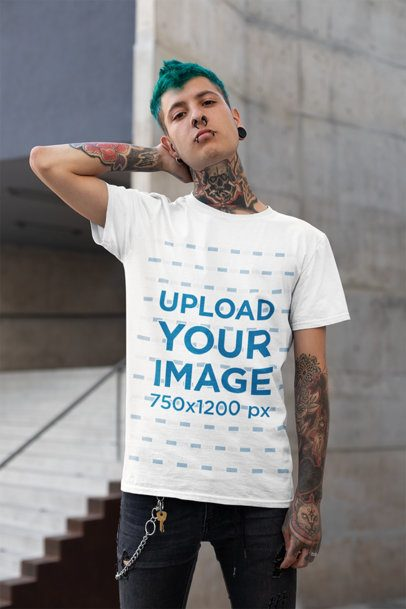 T-Shirt Mockup of a Punk Man with Blue Hair and Tattoos Posing by a Stairway 26480