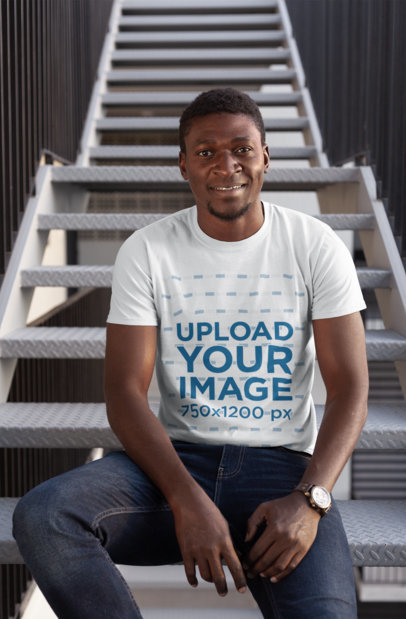 T-Shirt Mockup of a Man Sitting on a Stairway 26637