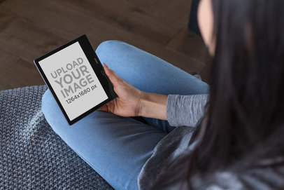 Over-The-Shoulder Mockup of a Woman Placing a Kindle Oasis on Her Lap 26028