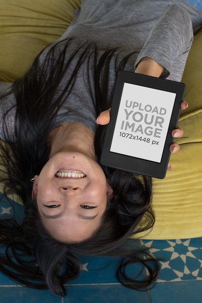 Upside-down Mockup of a Woman with Long Hair Showing Her Kindle Paperwhite 26033