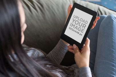 Mockup of a Woman Reading from Her Kindle Paperwhite 26036