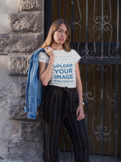 T-Shirt Mockup of a Blonde Woman Carrying a Denim Jacket 26355